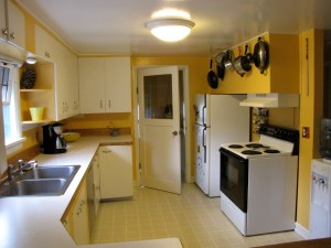 Sunny kitchen.  Door to basement and backyard.