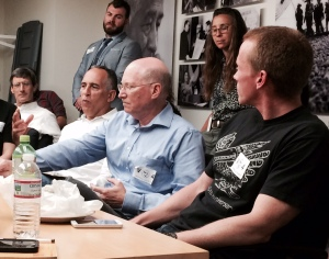 From left to right at the table: Freddy Kunkle of the Washington Post talked about organizing among skeptical media workers while NewsGuild-CWA organizing director Tim Schick and Hamilton Nolan of Gawker look listen.